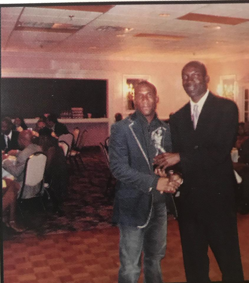 Glen Hall receives trophy from GSCL president Rohan Jones. (2006 Presentation)