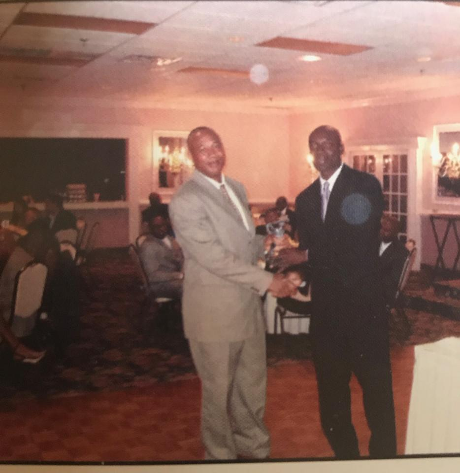 Legendary Roy Bryan receives 2006 batting award trophy from Rohan Jones